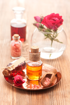 Rose essential oil, sea salt and flowers roses. Spa, body care, aromatherapy. Imagens