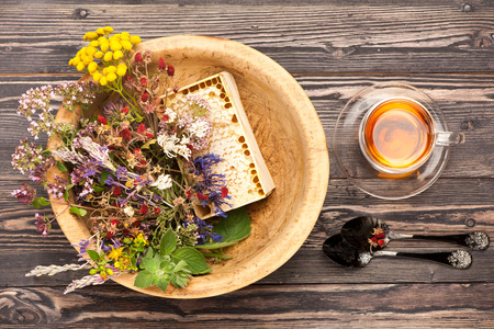 Medical herbs and flowers and herbal tea.  top view, horizontal Imagens