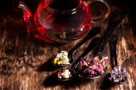 dried herbs: Various dried herbs and flowers and herbal tea in teapot