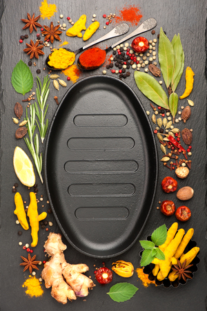 seasonings: Spices and seasonings with space for text. Top view, vertical. Top view, vertical Stock Photo