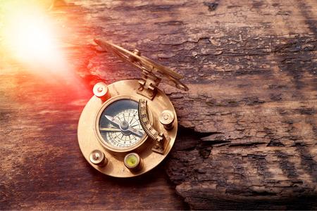 Old sundial with compass on sunny background Reklamní fotografie