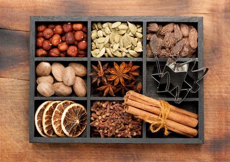 seasonings: spices, seasonings, spicy. Christmas baking ingredients in a wooden box. Top view