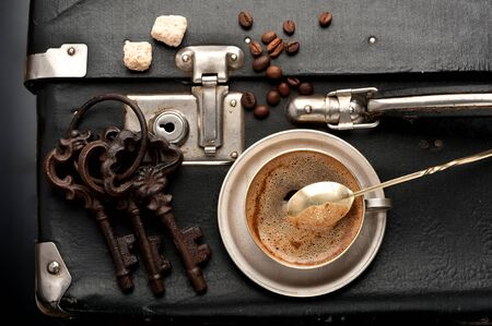 antique suitcase: cup Coffee , old suitcase and antique keys in retro style
