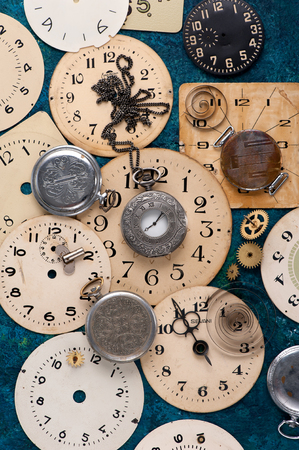timepiece: old pocket watch and face old clock, vintage background