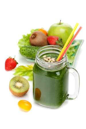 Green smoothies and ingredients on a white background Stock Photo