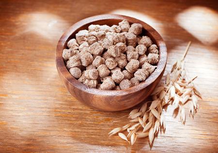bran: Bran fiber on a wooden background Stock Photo