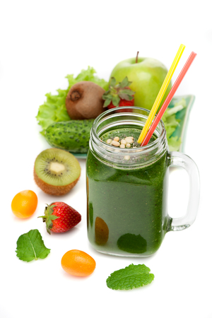 Green detox smoothies and ingredients on a white background Stock Photo