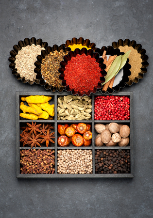 flavour: spices, spicy, seasonings  in wooden box , top view.