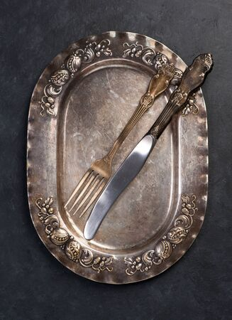 grunge cutlery: Vintage silver plate, knife and fork. Antique cutlery