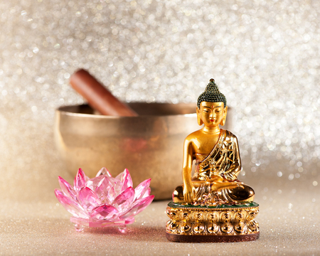 Singing Bowl, lotus flower and Buddha statue. meditation concept Stock Photo
