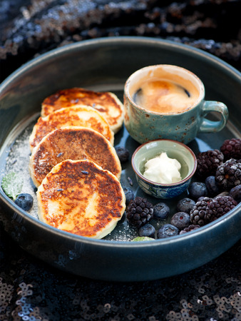Pancakes with cottage cheese and espresso cup