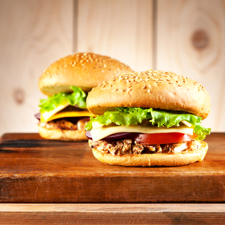 Two Burgers with turkey meat, cheese and vegetables Stock Photo