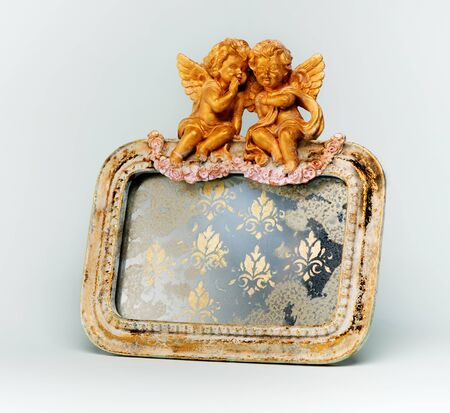 Antique mirror in a frame with Angels