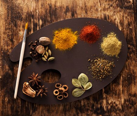 Indian spices, spicy and seasoning on an old wooden texture
