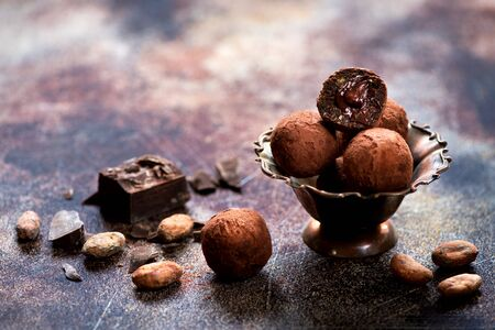 Chocolate sweets, cocoa beans and chocolate