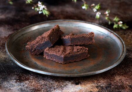 Chocolate brownie cake on a plate Banco de Imagens
