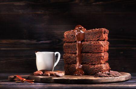 Pieces brownie chocolate cake and warm chocolate sauce
