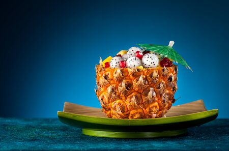 Exotic fruit salad of pineapple, dragon fruit and pomegranate