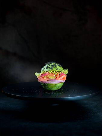 Avocado burger with salmon and vegetables. healthy vegan food concept 版權商用圖片