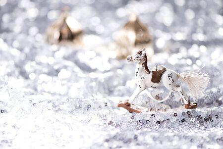 Shiny Christmas background and rocking horse Standard-Bild