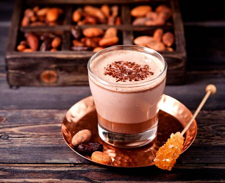 Hot chocolate or hot cocoa and cocoa beans