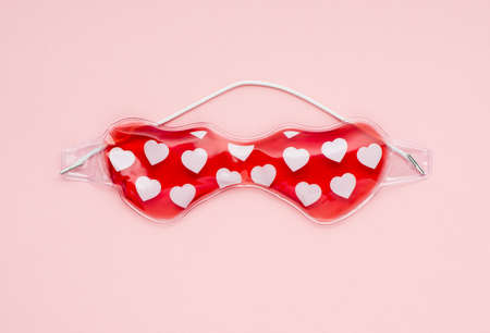 gel eye mask on pink background, flat lay top view. Facial care and beauty concept