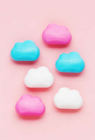 cute clouds on a pink background. baby or newborn background