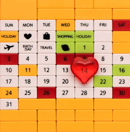 Perpetual calendar background with valentine's day and red heart, top view, close-up