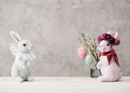 Happy Easter. Festive decoration with Easter eggs, willow branches and Easter bunny