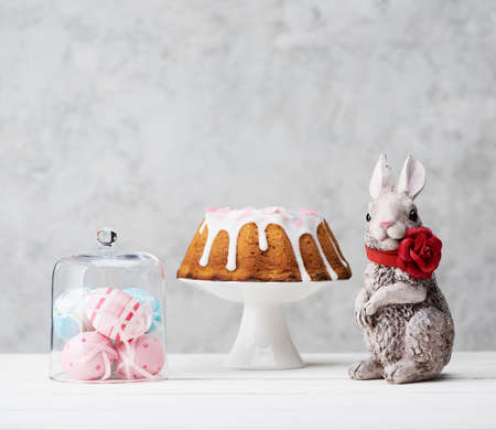 Easter cake, Bunny and colorful eggs. Happy Easter festive card