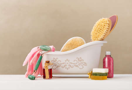 Spa and body care concept. Natural Organic cosmetics products, massage brush, gua sha massage roller. Eco Products for body and face care.
