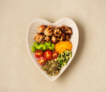Buddha bowl Balanced healthy diet. Grilled turkey fillet, avocado, fresh vegetables and sprouts with olive oil, top view. Ð¡lean eating concept. Stockfoto