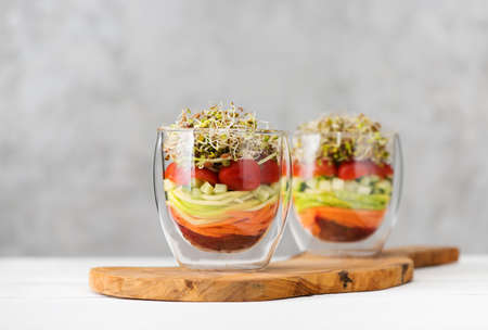 Salad in glass with microgreens and fresh vegetables. Healthy food, clean eating and vegetarian concept Stockfoto