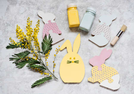 Child Game Easter wooden bunnies puzzle. Happy easter for kids. Creative Idea for children's creativity