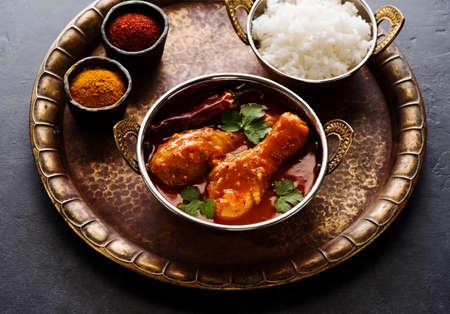 Spicy Chicken Curry. Spicy chicken legs with rice. Top view Standard-Bild