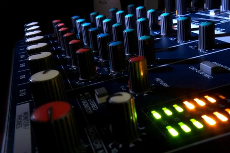 audio mixer: Mixing console at night. Musical background.