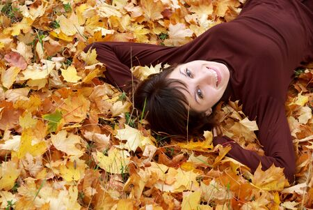 Girl in the autumn leafs. Element of design. photo
