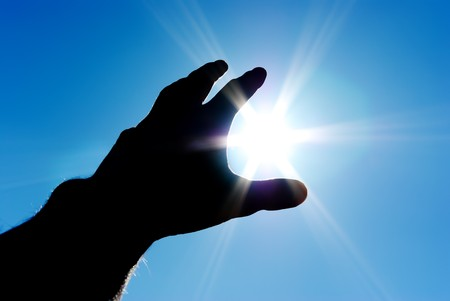 get in touch: Sun in hand. Conceptual design. Stock Photo