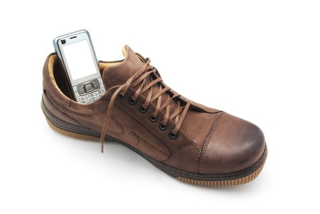 Mobile phone in shoe. Concept design. Stock Photo - 7725402
