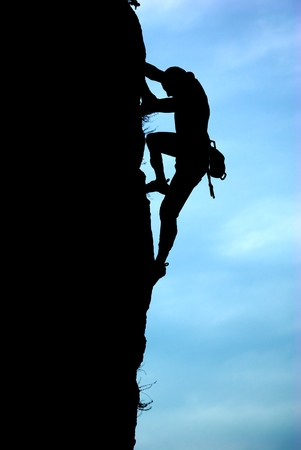 Silhouette of climber. Element of deisgn. photo