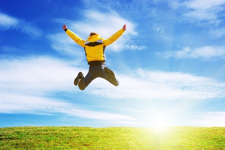 joy of life: Man jump on the green meadow. Emotional scene. Stock Photo