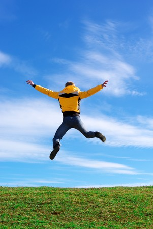 Man jump on the green meadow. Emotional scene. Stock Photo - 7746292