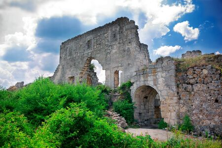 grassy knoll: Ruins of old castle. Nature composition. Stock Photo