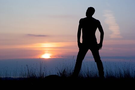 Man at the sunset.  photo