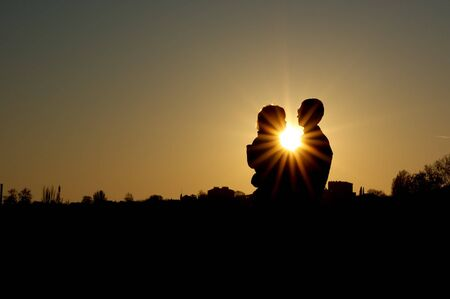 Couple in the sunset. Romantic scene. Stock Photo - 8245127