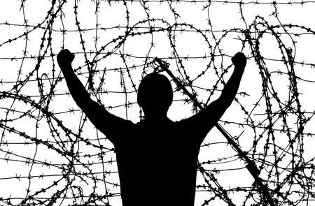 barbed wire fence: Man in prison. Conceptual design.