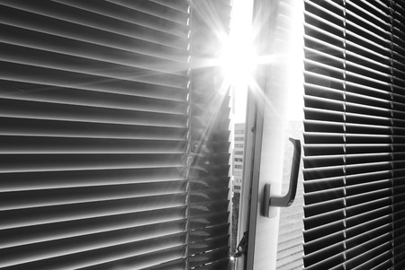 a blind: Sun through the window. Element of design.