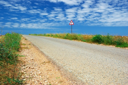 Long road in desert and  traffic sign. Nature composition. Stock Photo - 8364328