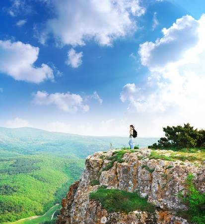 Girl on the peak of mountain. Landscape composition. photo