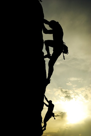 Silhouette of climber at the sunset. Element of deisgn. photo